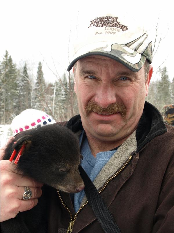 Bert Goodman with bear cub