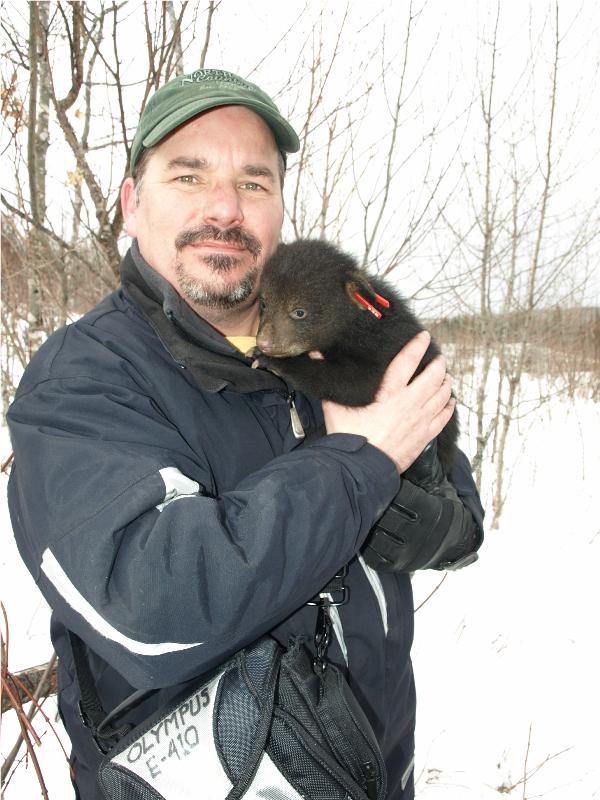 Hank Goodman with bear cub